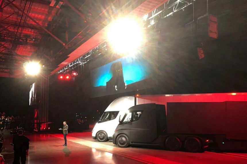 Tesla CEO Elon Musk shows off the Tesla Semi as he unveils the company's new electric semi truck during an presentation in Hawthorn, California on Nov 16, 2017.