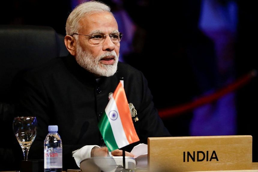 India's Prime Minister Narendra Modi participates in the opening session of the 15th Asean-India Summit at the Philippine International Convention Centre in Manila.