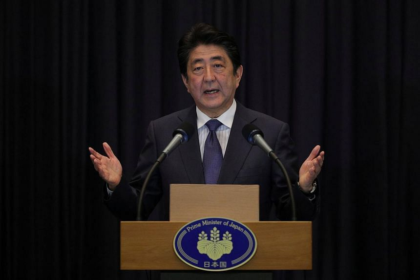 Japan's Prime Minister Shinzo Abe gestures during a news conference at the end of the 31st ASEAN Summit in Manila.
