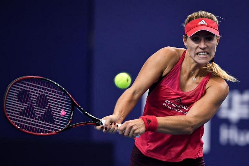 Angelique Kerber hits a return against Ashleigh Barty during their women's singles match at the Zhuhai Elite Trophy tennis tournament.