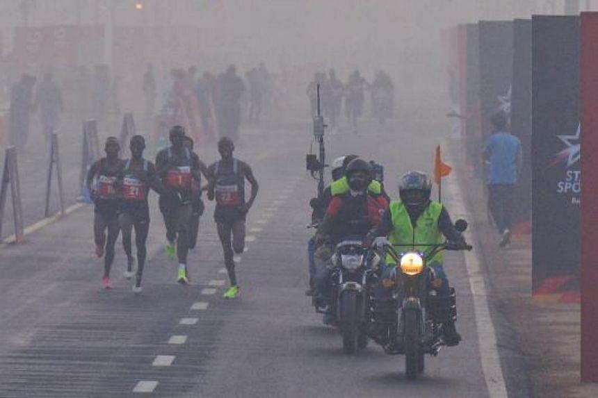 Participants running the Delhi Half Marathon in smog-choked New Delhi on Nov 20, 2016.