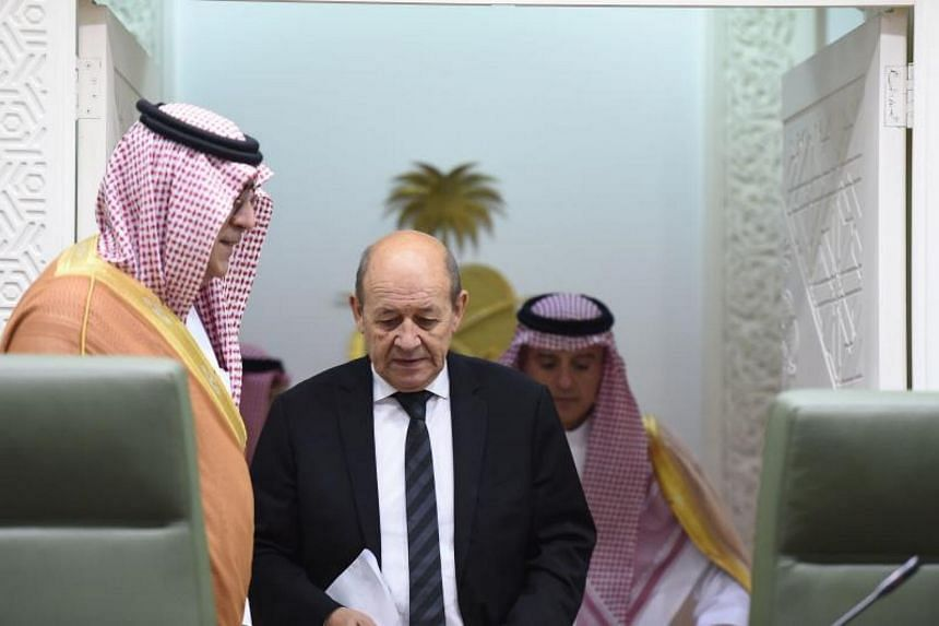 """France's Foreign Minister Jean-Yves Le Drian (centre) accused Iran of """"hegemonic"""" ambitions in the Middle East during his visit to Saudi Arabia on Thursday (Nov 16)."""