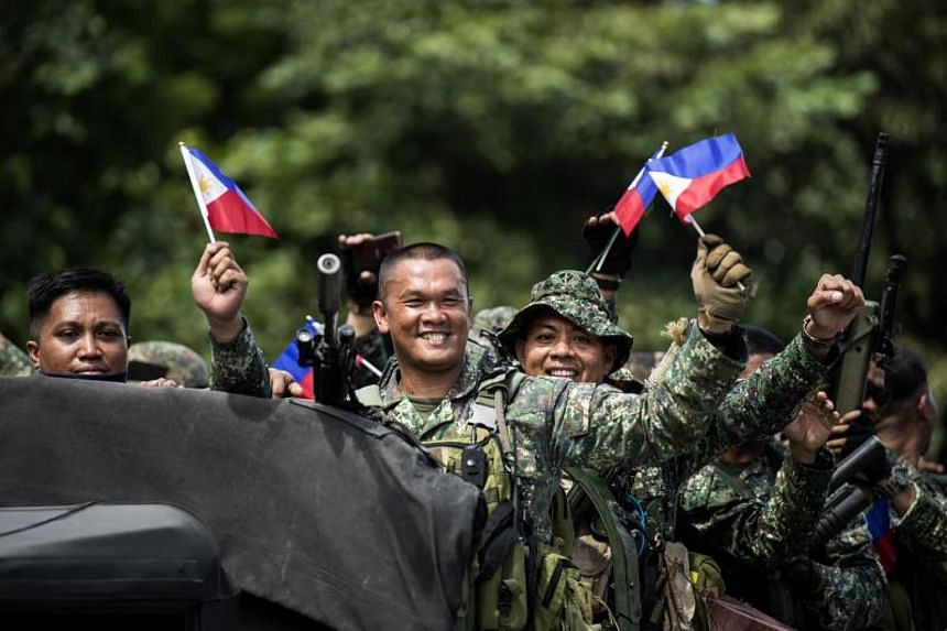 Philippine soldiers arrive at the port of Manila on Oct 30, 2017, after a five-month deployment against ISIS supporters in Marawi.