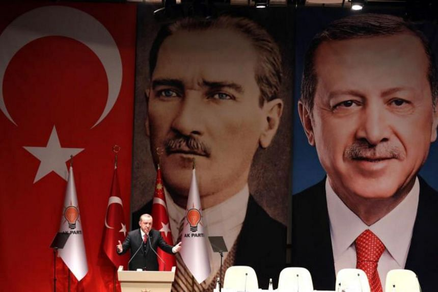 """Turkish President Recep Tayyip Erdogan said an """"enemy poster"""", featuring his name on one side and a picture of modern Turkey's founder, Mustafa Kemal Ataturk, on the other, was unfurled at the training exercise in Norway."""