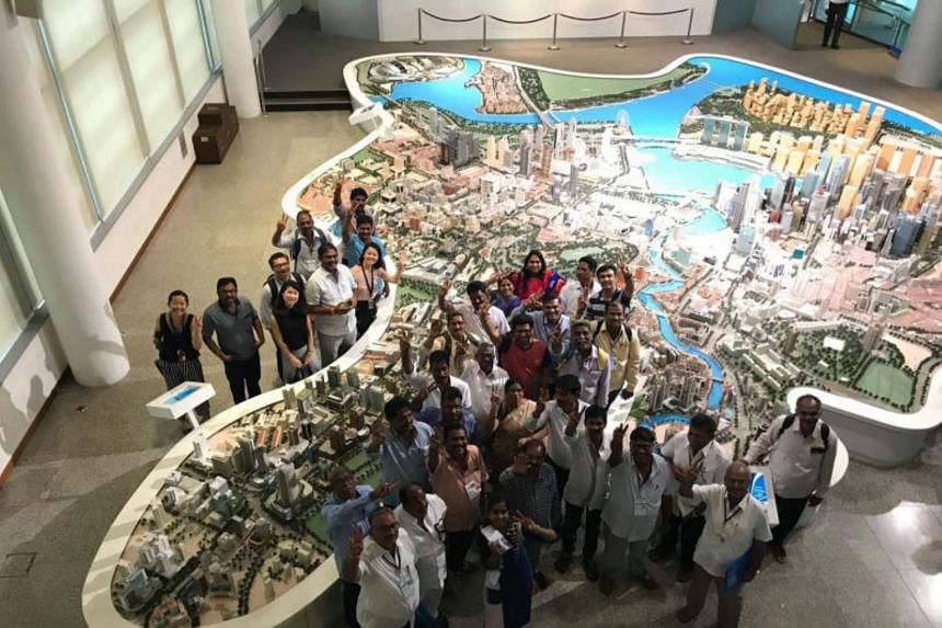 Farmers from Andhra Pradesh visiting the Singapore City Gallery at The URA Centre (URA) to learn more about Singapore's urban development history earlier this month.