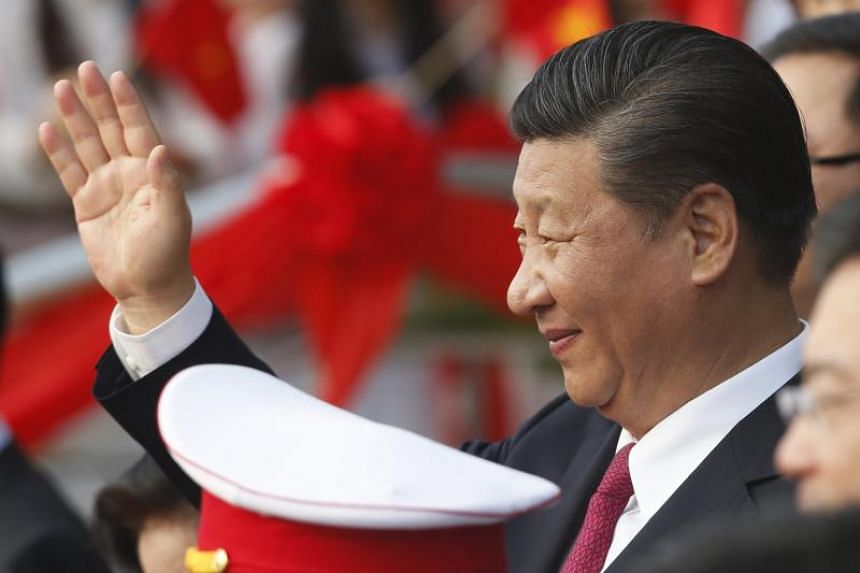 China's President Xi Jinping waves after attending the inauguration ceremony of the Chinese sponsored Vietnam-China Cultural Friendship Palace in Hanoi, Vietnam.