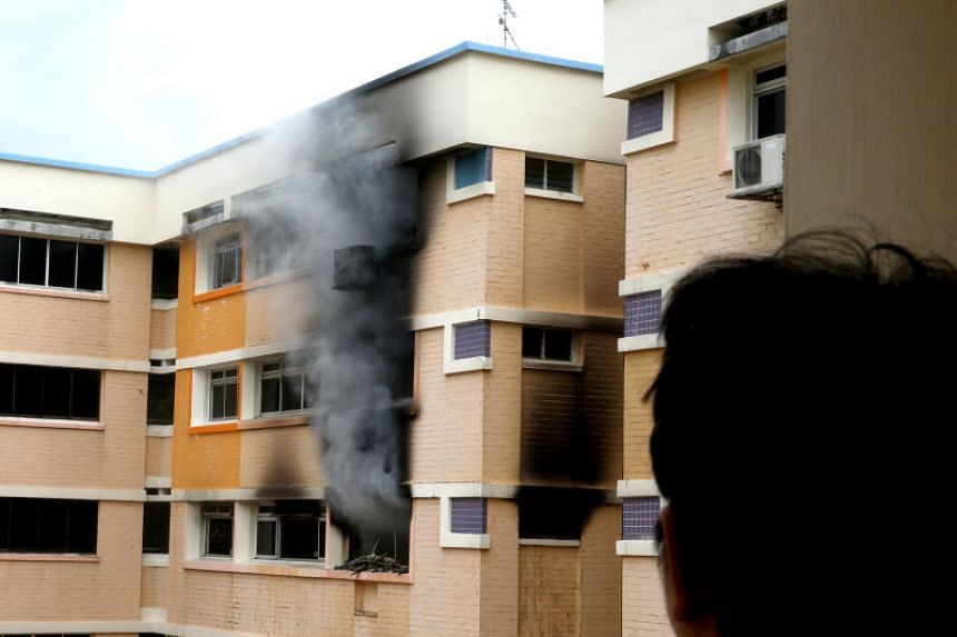 File photo of thick smoke billowing from a HDB flat.