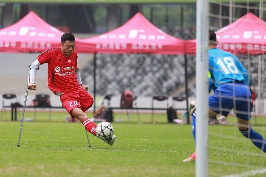 He Yiyi kicks the ball during a football match with a local team in Guangzhou, Guangdong province.