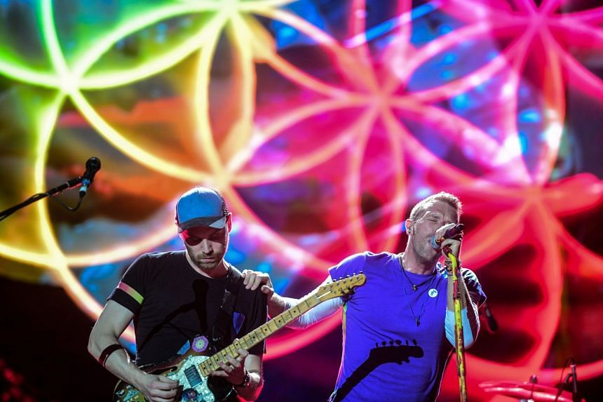 Coldplay perform at the National Stadium in Singapore, March 31, 2017.