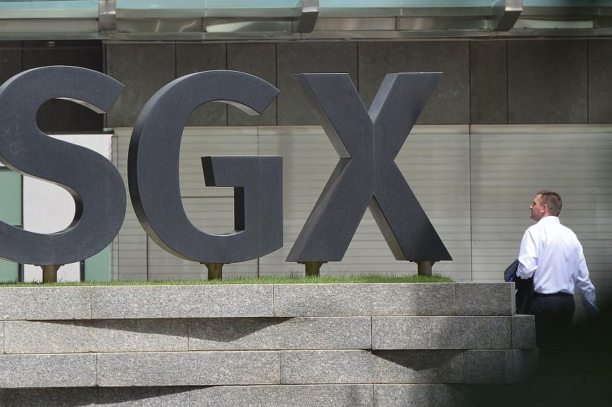 A man walking past the SGX building in the central business district.