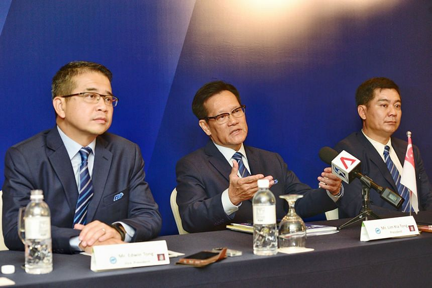 From left: Football Association of Singapore (FAS) vice-president Edwin Tong, president Lim Kia Tong and deputy president Bernard Tan at the national body's 35th Annual Congress at the Holiday Inn Singapore Orchard City Centre yesterday.