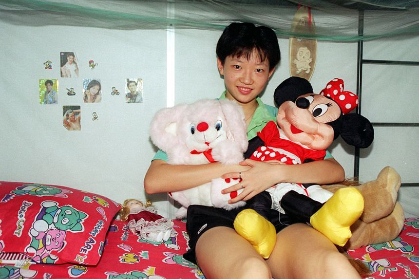 Li Jiawei, then only 15 years old, in her room at the Singapore Table Tennis Association dormitory in 1997. Her parents convinced the Chinese authorities to let her leave the country of her birth to move to Singapore.