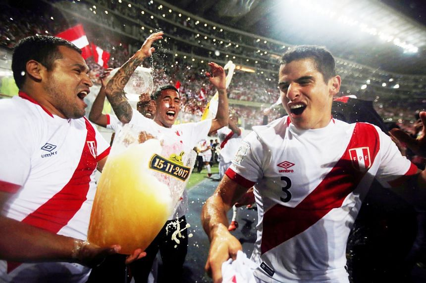 Peruvian players celebrate after becoming the last side to qualify for the 2018 World Cup after their 2-0 second-leg win against New Zealand at the National Stadium, Lima on Wednesday. Peru have not figured in the World Cup Finals since 1982.