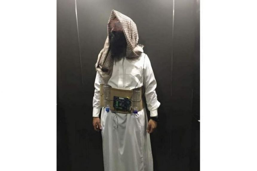 Amjad Jalal Ahmed Al Dahan dressed as a suicide bomber for a Halloween party.