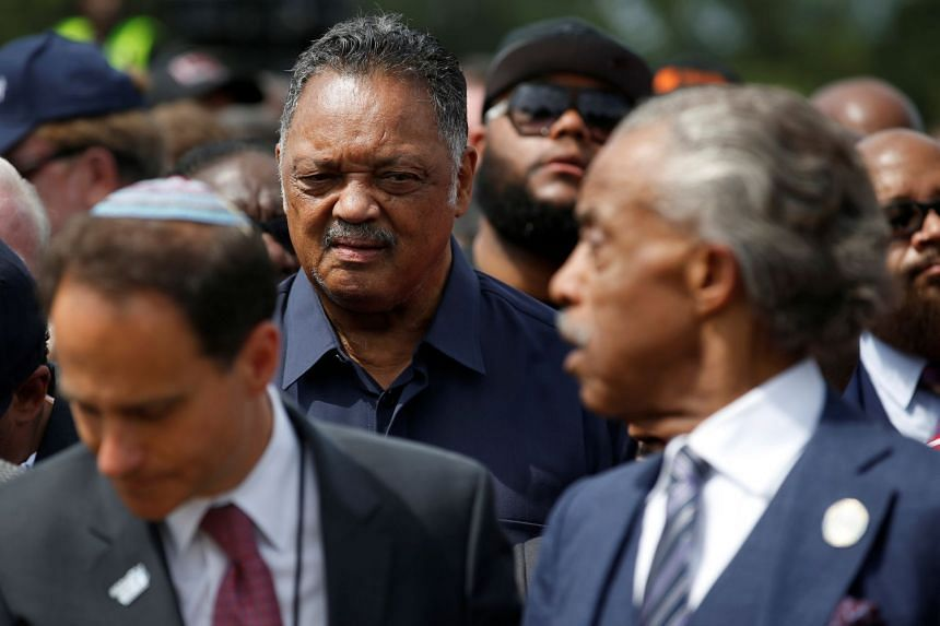 Reverend Jesse Jackson (left) looks to Reverend Al Sharpton (right) at a Washington march in August 2017.