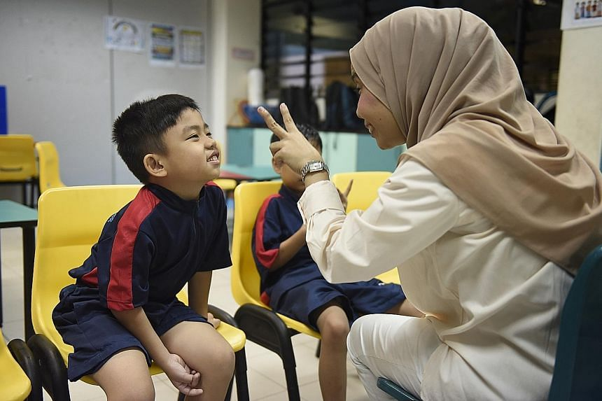 A pupil with autism with his teacher at Minds Woodlands Gardens School. The Ministry of Education said it will ensure that Singaporean children with moderate to severe special needs can access learning in a suitable special education school.