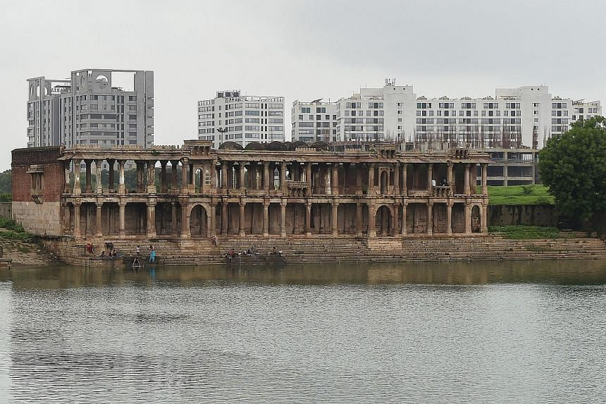 The ruins of the 15th century Tombs of the Queens building at the Sarkhej Roza complex in Ahmedabad. The city's crumbling, 600-year-old mosques, traditional markets and ornate homes have been named India's first Unesco city, despite objections from h
