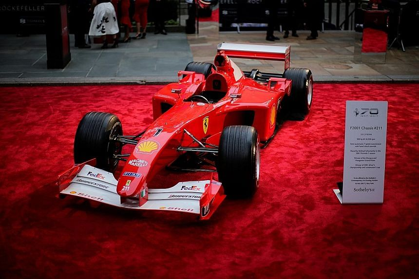 Michael Schumacher's Grand Prix-winning Ferrari, seen here on display at the Rockefeller Plaza in New York last month, sold for US$7.5 million (S$10.2 million) on Thursday at a Sotheby's auction. It was the first time that a rare car was included in