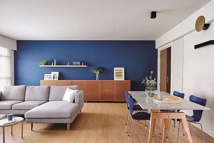 Two bedrooms have been combined to create a larger master bedroom (left) for home owners Si Jian Wen and Sharon Teo (below left). It is separated from the dressing area (above) by a low console. The bomb shelter's ventilation fragmentation plate gets