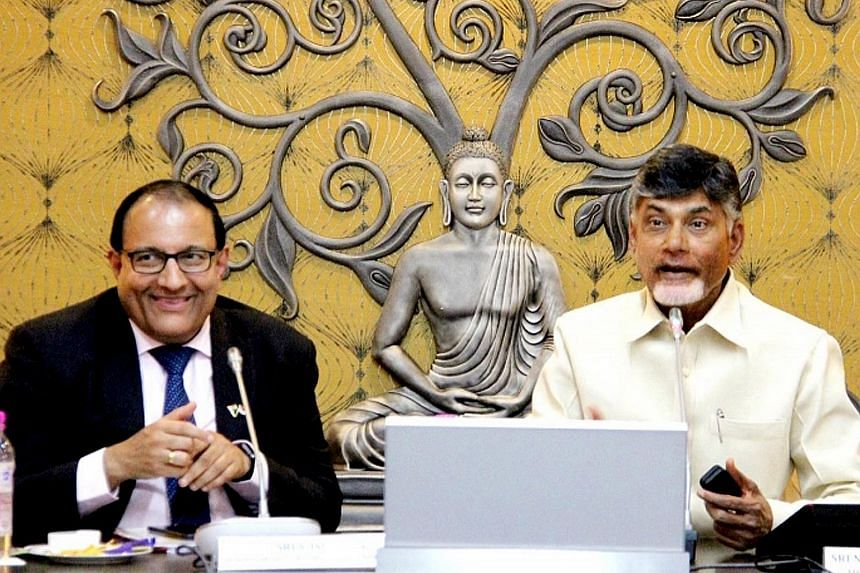 """Singapore Minister for Trade and Industry (Industry) S. Iswaran (left) with Andhra Pradesh Chief Minister Chandrababu Naidu in the Indian state yesterday. They hailed the """"very good progress"""" made on Amaravati."""