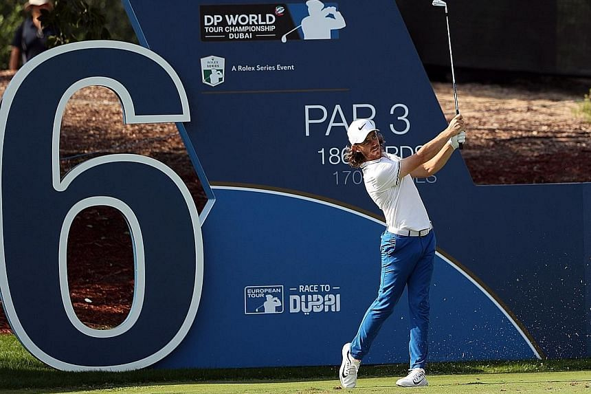 England's Tommy Fleetwood in action in the second round of the DP World Tour Championship at the Jumeirah Golf Estates in Dubai yesterday. He made up for his first-round score with a 65 to put himself back in the Race to Dubai contention.