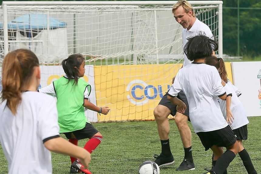 Former Liverpool and Finland defender Sami Hyypia conducting a football clinic for girls, organised by Courts, at The Arena in Woodleigh Park yesterday.