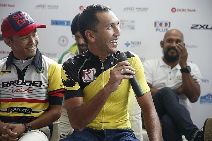 Malaysia team captain Muhammad Fauzan Ahmad Lutfi (front) talking up his team's chances in the OCBC Cycle Speedway South-east Asia Championship at yesterday's press conference at Hotel Jen Orchard Gateway. The two-time defending champions have a task