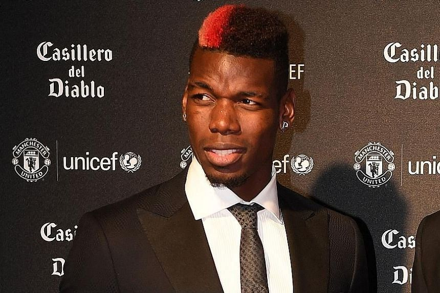 Paul Pogba attending a Unicef charity dinner on Wednesday. The midfielder will return to bolster the Manchester United squad today.