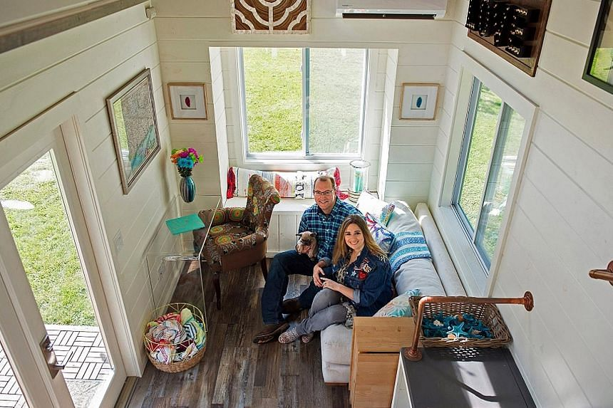 Couple Tori and Ken Pond (above), who own a tiny-house building company called Craft & Sprout, in their model home in their backyard (left).
