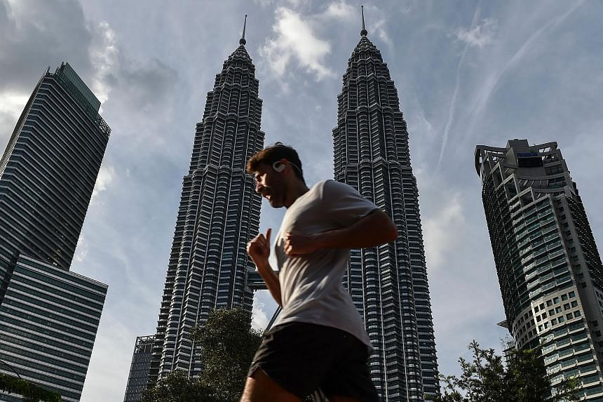 Exports and private consumption will likely remain strong enough to prop up the economy in the next quarter, Malaysia's central bank said.