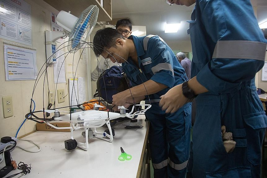 A drone being assembled (above). Using such machines for remote inspection, such as checking the internal structures in the cargo hold of a ship (left), can make the work of marine surveyors easier.