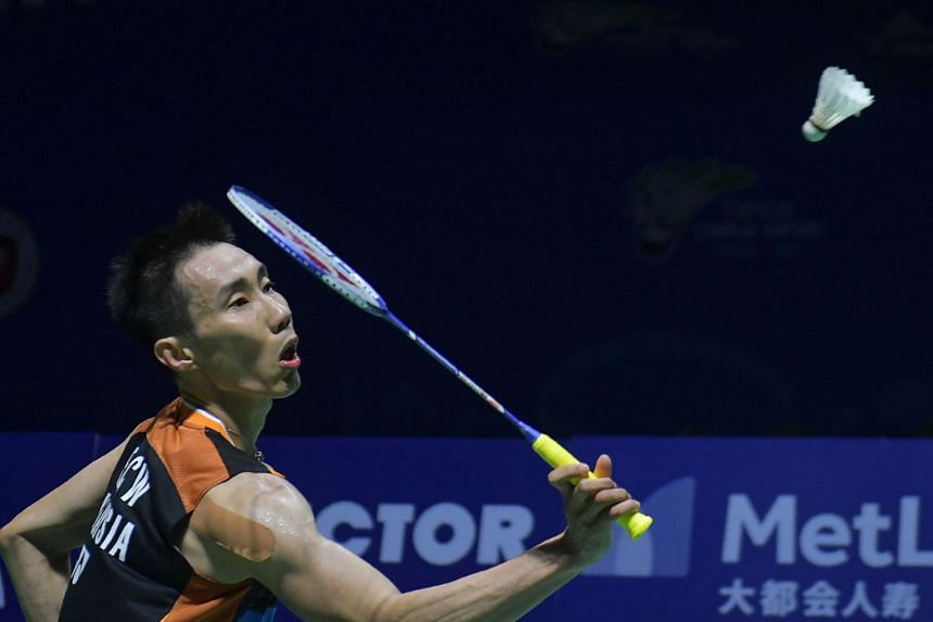 Lee hits a return against Angus Ng Ka-Long of Hong Kong during their men's singles quarter-final match.