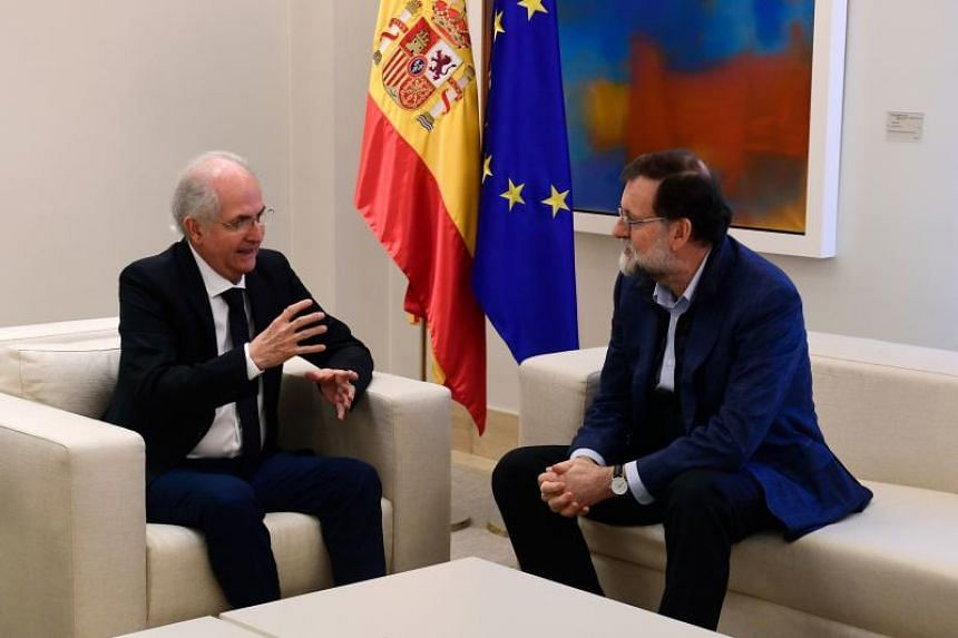 Spanish Prime Minister Mariano Rajoy listens to former Caracas mayor Antonio Ledezma (left) during a meeting in Madrid on Nov 18, 2017.