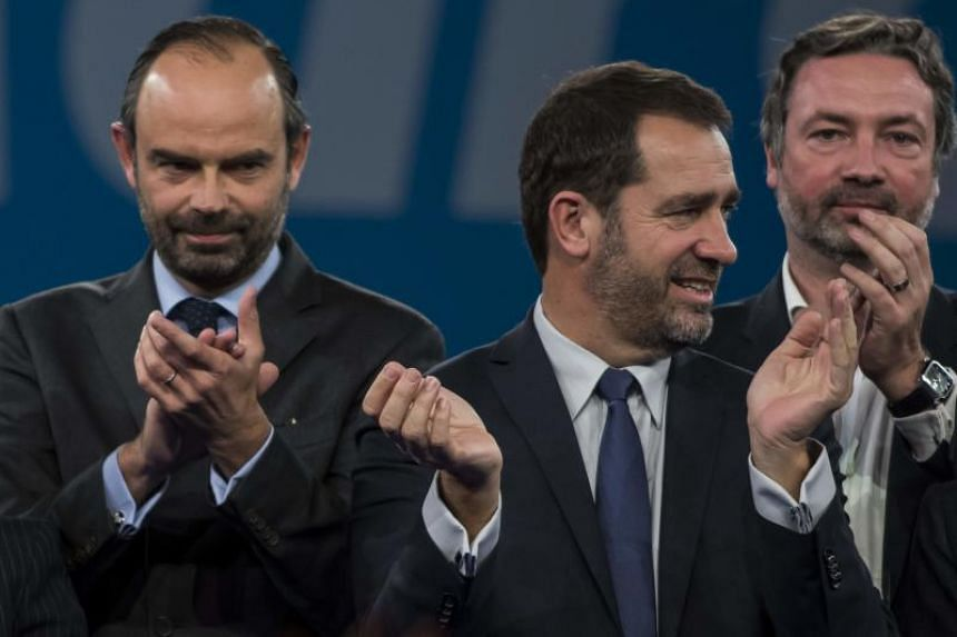 French Prime Minister Edouard Philippe (left) and French MP Arnaud Leroy (right) applaud next to newly elected leader of the LREM Christophe Castaner (centre) during the council of the LREM party at Eurexpo Lyon on Nov 18, 2017.