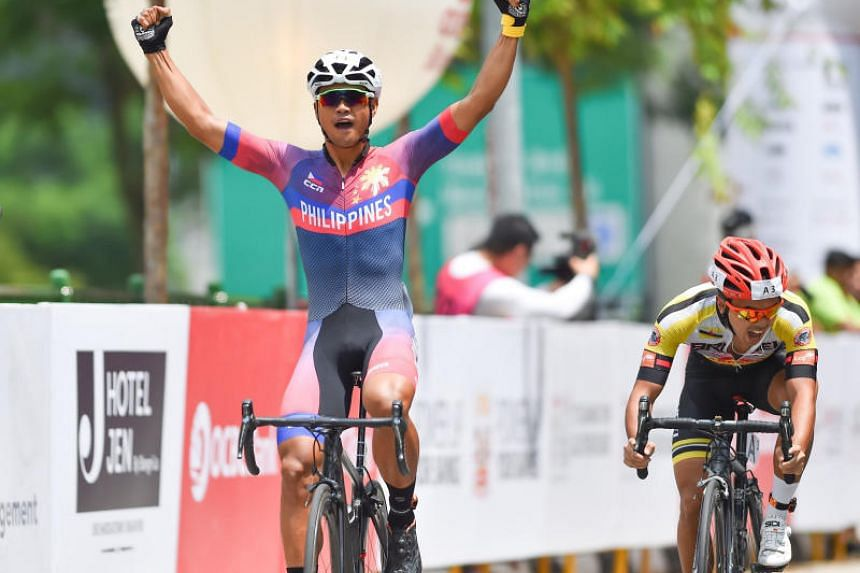 Ronald Nozuelo Oranza of the Philippines celebrates as he crosses the finish line at the OCBC Cycle Southeast Asia Speedway Championship.