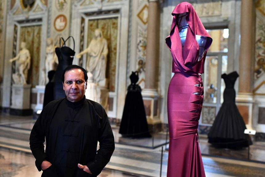 A 2015 photo shows Alaia posing during a press preview of the exhibition