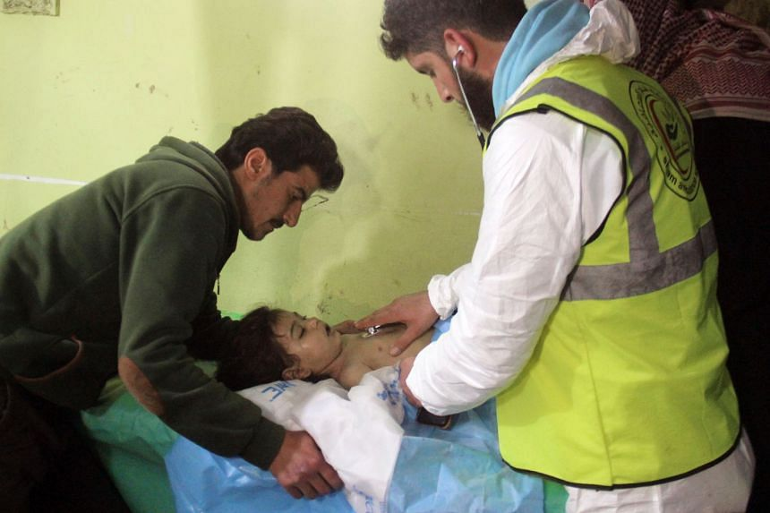 An unconscious child receiving treatment following a suspected toxic gas attack in Syria.