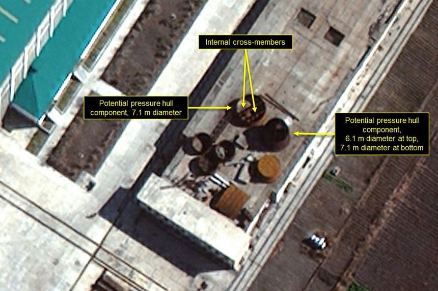 An image taken of North Korea's Sinpo South Shipyard on Nov 5 shows large circular objects that could be sections of a submarine's pressure hull. 38 North said there had been continued movement of parts and components into and out of the shipyard