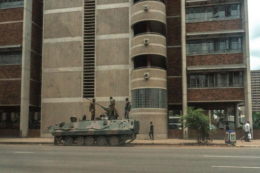 An armoured personnel carrier on the streets of Harare yesterday, a common sight since the military took over the Zimbabwean capital this week.