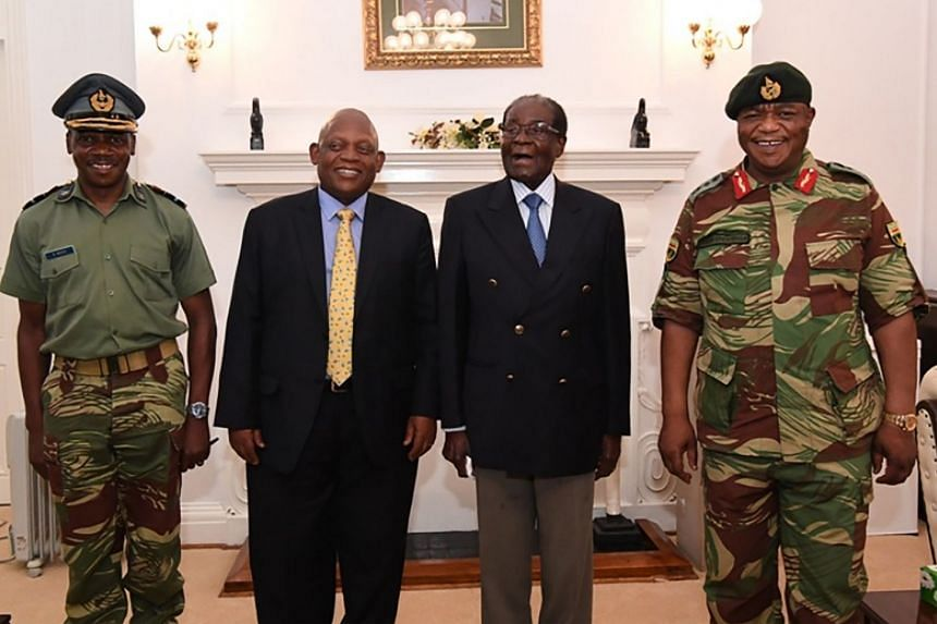 From right: Military chief Constantino Chiwenga with Zimbabwe President Robert Mugabe and South African envoys at State House in Harare, in a screengrab from Zimbabwe Broadcasting Corporation taken on Thursday. The image stunned Zimbabweans who thoug