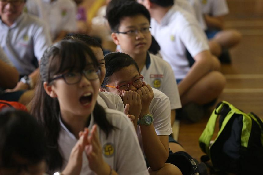 Students at Lianhua Primary School reacts when the summary of the school's Primary School Leaving Examination (PSLE) results was shown on Nov 4, 2016. This year's PSLE results will be released on Nov 24.