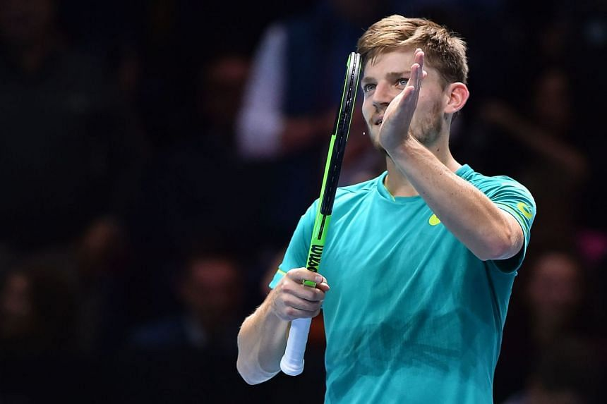 Goffin gestures to the crowd after his straight sets win over Austria's Dominic Thiem.