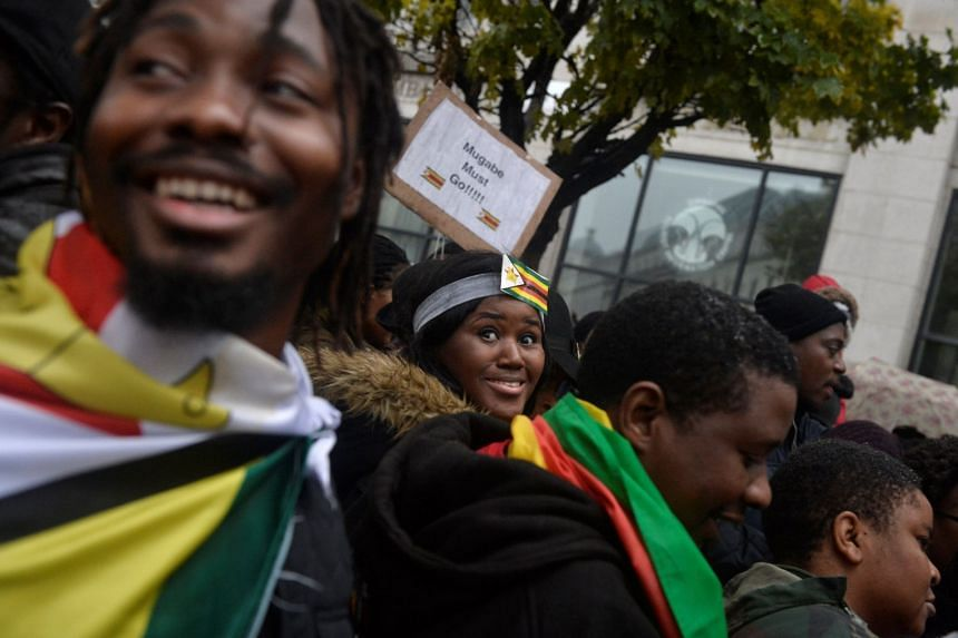Protesters calling for Zimbabwean President Robert Mugabe to step down gather in London.