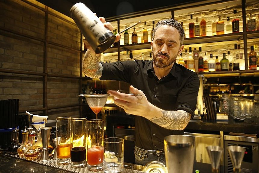 The Loco Group's beverage director Ajay Parag with a fruit mocktail. (Left) One-Ninety's head bartender Joseph Haywood with The Artist's Special cocktail. (Above) Catchfly's bartender Liam Baer making a low ABV cocktail.