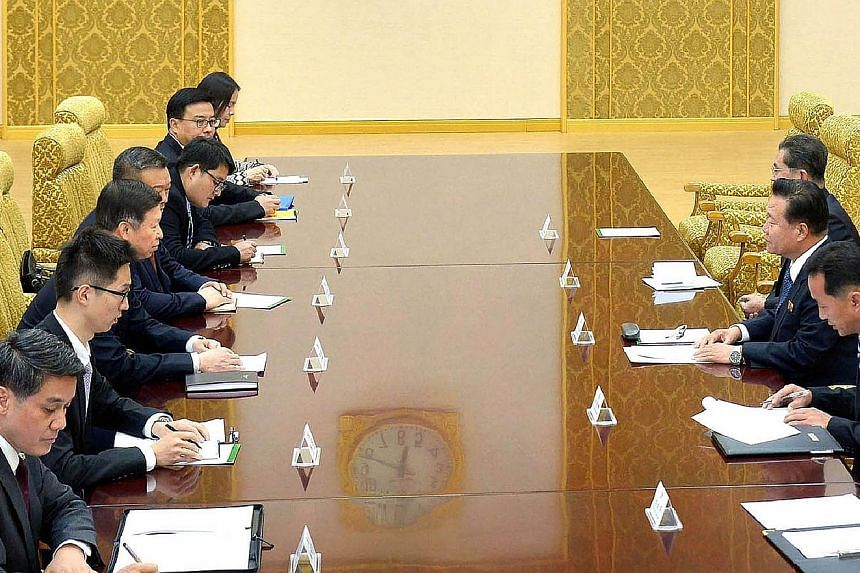 Senior Chinese envoy Song Tao (left, third from bottom) meeting North Korean leader Kim Jong Un's close aide Choe Ryong Hae (right, second from bottom) in Pyongyang on Friday. Each side's account of the talks said both stressed the importance of ties