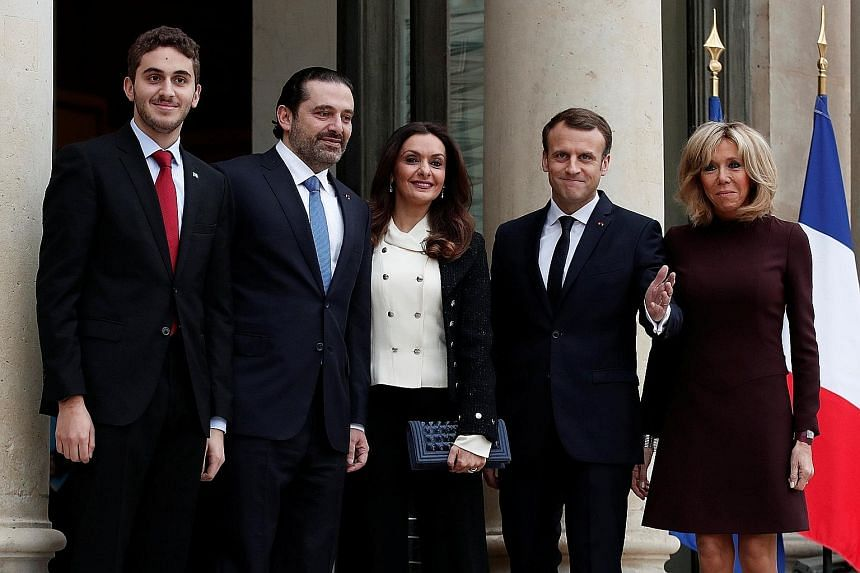 Lebanese Prime Minister Saad al-Hariri (second from left in picture), his wife Lara and their son Hussan with French President Emmanuel Macron and his wife Brigitte at the Elysee Palace in Paris yesterday. Mr Hariri accused Iran and its powerful Leba