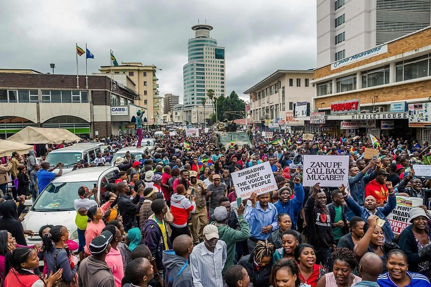 People on their way to a rally in the Harare township of Highfield yesterday. Many marched in the direction of Mr Mugabe's residence. Demonstrators rallying on the streets of Harare yesterday to demand President Robert Mugabe's resignation. He is the
