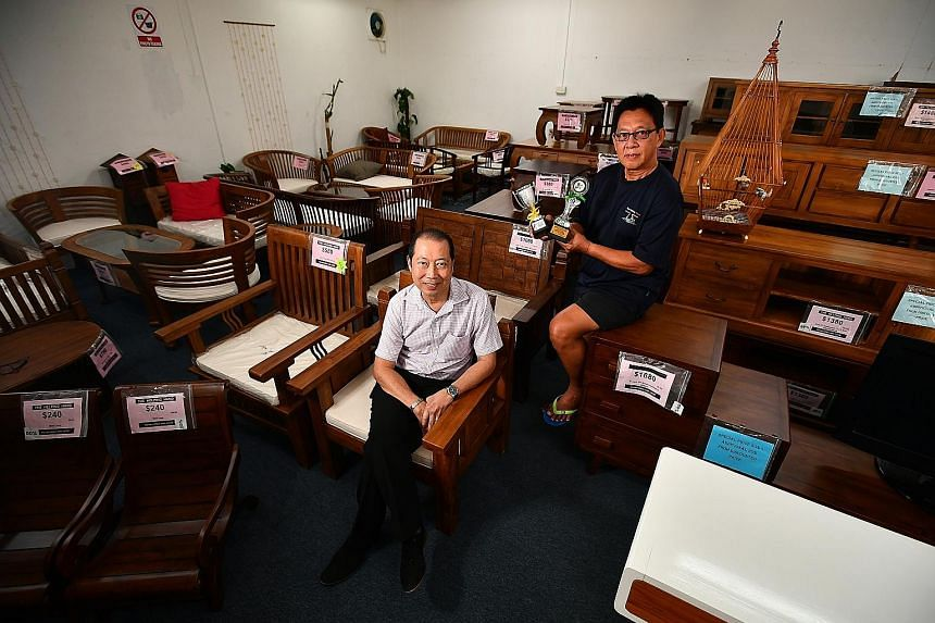 The Helping Hand liaison and training manager Vincent Tan (left) and Mr Tan Chin Nam, a former offender who underwent a rehabilitation programme there and now helps to run the halfway house. With Mr Tan is one of his pet songbirds, which helped him w