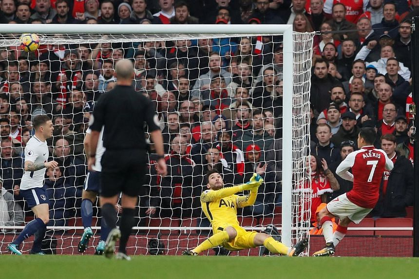 Alexis Sanchez rifling the ball past Hugo Lloris into the roof of the Spurs net to make it 2-0 to Arsenal.