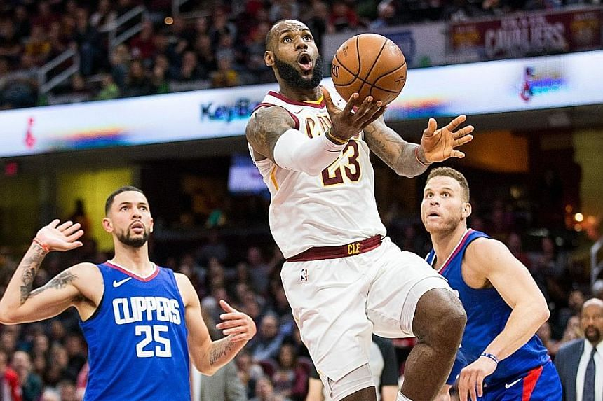 LeBron James driving to the basket as he helped the Cleveland Cavaliers claw back a 15-point deficit to beat the LA Clippers 118-113.